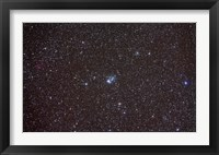 Framed Open cluster NGC 457 in the constellation Cassiopeia
