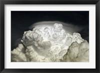 Framed Cumulus Congestus cloud with Pileus