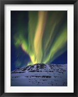 Framed Aurora Borealis over Toviktinden Mountain in Troms County, Norway