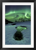 Framed Aurora Borealis over a frozen river, Norway