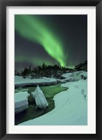 Framed Aurora Borealis over a frozen Tennevik River, Troms, Norway