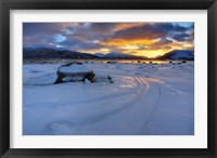 Framed winter sunset over Tjeldsundet at Evenskjer, Troms County, Norway