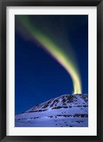 Framed aurora borealis shooting up from Toviktinden Mountain, Norway