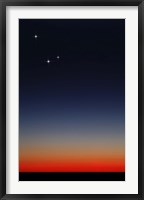 Framed Venus, Mercury and Mars above the glowing horizon at dawn