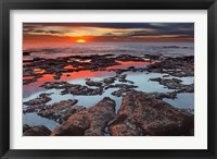 Framed Tidal pools reflect the sunrise colors during the autumn equinox