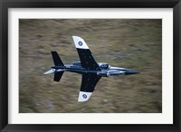 Framed Alpha Jet of the Royal Air Force low level flying over North Wales
