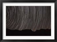 Framed Star trails above a valley in the Firoozkooh area, Iran