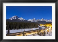 Framed moonlit nightscape over the Bow River and Morant's Curve in Banff National Park, Canada