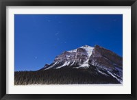 Framed Orion star trails above Mount Fairview, Alberta, Canada