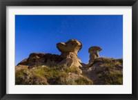 Framed Starry sky above hoodoo formations at Dinosaur Provincial Park, Canada