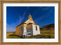 Framed old pioneer church in Dorothy, Alberta, Canada, on a starry night