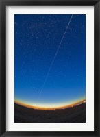 Framed Trail of the International Space Station coming out of the western twilight