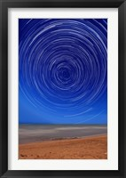 Framed Star trails around the south celestial pole at the beach in Miramar, Argentina