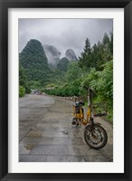 Framed Bicycle sits in front of the Guilin Mountains, Guilin, Yangshuo, China