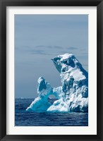 Framed arched iceberg floating in Gerlache Strait, Antarctica.