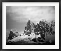 Framed Antarctica, Mountain peaks along Cape Renaud in Lemaire Channel.