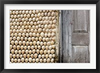 Framed Cowrie shells on wall of building, Ibo Island, Morocco