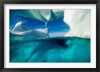 Framed Antarctica, Arched Iceberg floating near Enterprise Island.