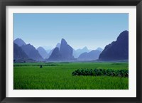 Framed Farmland with the famous limestone mountains of Guilin, Guangxi Province, China