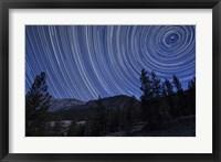 Framed Star trails above mountain peaks near Yosemite National Park, California