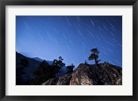 Framed Whisps of moonlight shine through the mountain peaks of Inyo National Forest