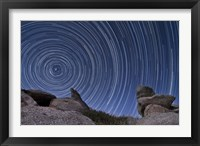 Framed boulder outcropping and star trails in Anza Borrego Desert State Park, California