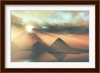 Framed Sunrays shine down on three pyramids along the Nile River on the Giza Plateau