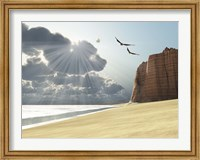 Framed Sunlight shines down on two birds flying near a cliff by the ocean