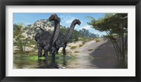 Framed Two Apatosaurus dinosaur wade through a lush pond