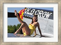 Framed Cute pin-up girl sitting on the wing of a P-51 Mustang