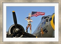Framed 1940's style majorette pin-up girl on a B-17 bomber with an American flag