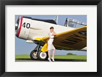 Framed 1940's style Navy pin-up girl leaning on the wing of a T-6 Texan