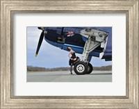 Framed 1940's style pin-up girl resting on the wheel of a TBM Avenger