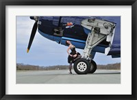 Framed 1940's style pin-up girl resting on the wheel of a TBM Avenger