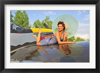 Framed 1940's style pin-up girl with parasol on a vintage P-51 Mustang