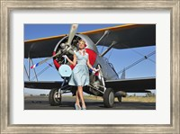 Framed Elegant 1940's style pin-up girl standing in front of an F3F biplane
