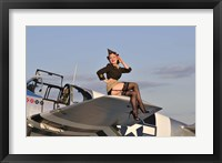 Framed Pin-up girl sitting on the wing of a P-51 Mustang