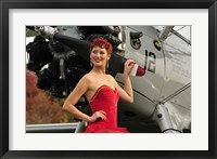 Framed Redhead pin-up girl in 1940's style dancer attire holding on to a vintage aircraft propeller