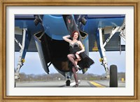 Framed 1940's style pin-up girl in cocktail dress posing in front of a TBM Avenger