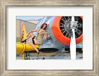 Framed 1940's style pin-up girl posing on a T-6 aircraft