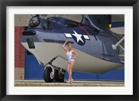 Framed pin-up girl posing with a Catalina seaplane