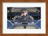 Framed Retro pin-up girl posing with a World War II era PBY Catalina seaplane