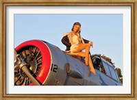 Framed 1940's style aviator pin-up girl posing with a vintage T-6 Texan aircraft