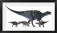 Maiasaura dinosaur with offspring Framed Print