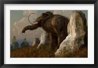 Framed mammoth standing among stones on a hillside