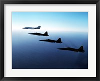 Framed Three F-5E Tiger IIs fly in formation with a Learjet 25