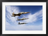 Framed F-5F Tiger II leads two F-5E's during a training flight