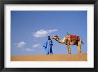 Framed Man leading camel on sand dunes, Tinfou (near Zagora), Morocco, Africa