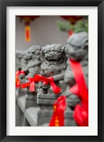 Framed Stone lions with red ribbon, Jade Buddah Temple, Shanghai, China
