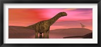 Framed Argentinosaurus dinosaurs amongst a colorful red sunset